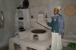 Our lovely tour guide showing us how they make injera in the community kitchen